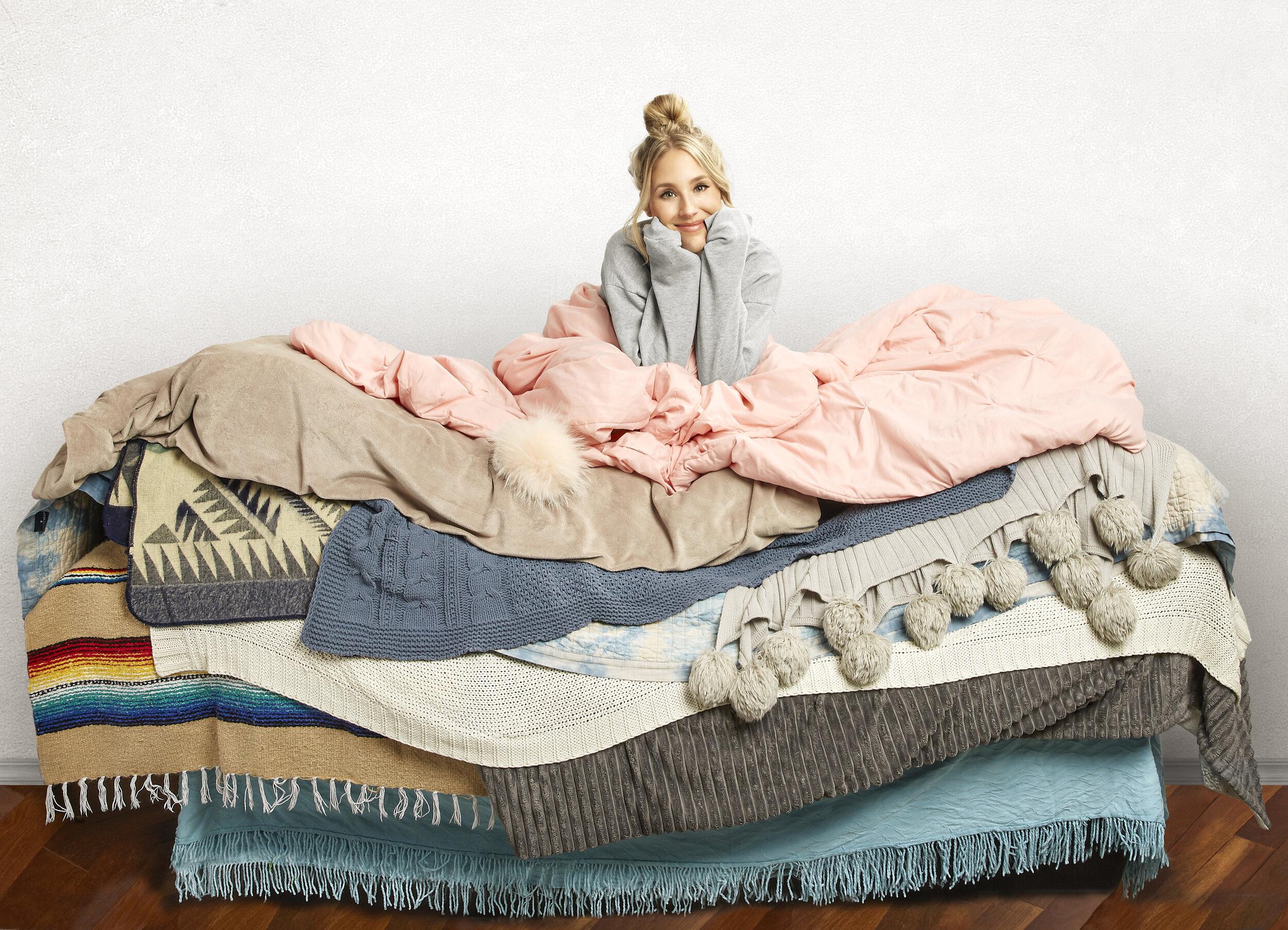 Lisa Gilroy on a pile of blankets